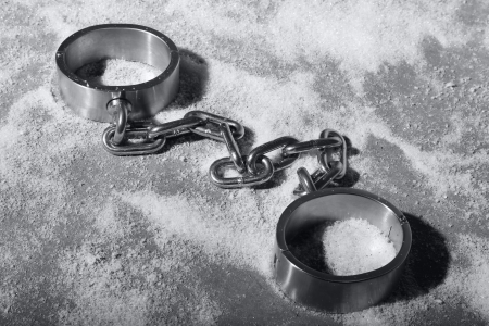 cuffs: hard steal or iron handcuffs or cuff laying in the snow