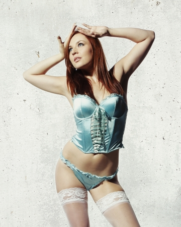 blue lingerie: beautiful woman with red hair is posing in blue lingerie