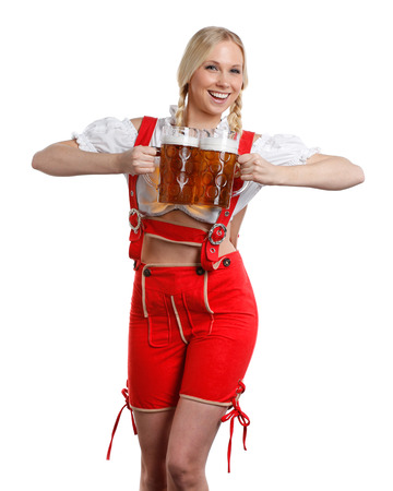 very beautiful woman in tiroler oktoberfest dress or dirndl is holding a big glass of beer in her hands photo