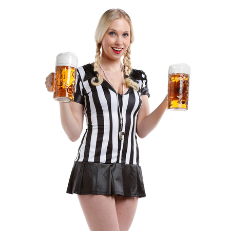 very happy and sexy beautiful woman in soccer referee clothes with a big glass of beer in her hands ready to party photo