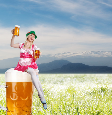 crazy tiroler or oktoberfest woman with a big glass of beer in her hands is sitting on a beer  photo