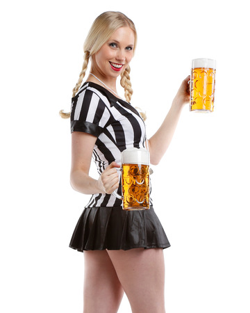 football party: very beautiful and happy woman in soccer sports outfit with a big glass of beer in her hands