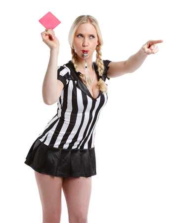 beautiful and sexy woman in soccer referee playing shirt is holding her red card up photo