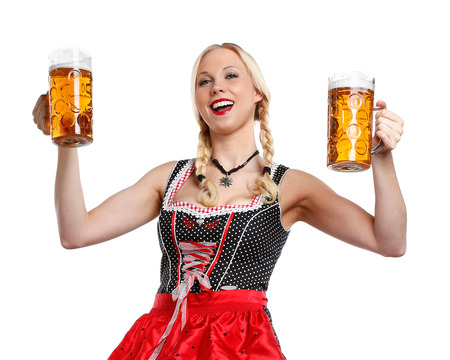 dirndl: very beautiful woman in tiroler oktoberfest dress or dirndl is holding a big glass of beer in her hands