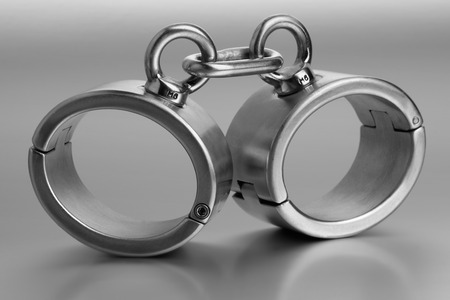 shackles: closeup of hard steel handcuffs or cuffs Stock Photo