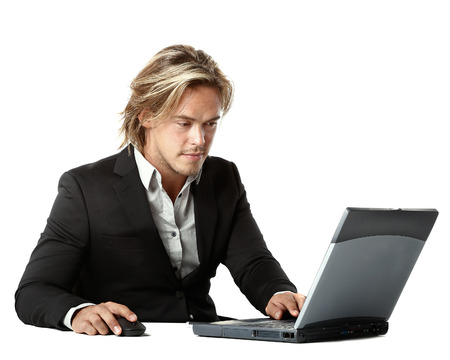 beautiful and sexy man is working behind his laptop computer at the office photo