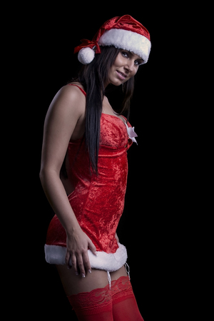 Woman in a sexy christmas santa look photo