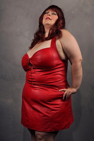 big beautiful woman in a red dress Stock Photo