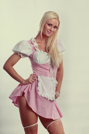 beautiful woman dressed in tiroler oktoberfest style and image background vintage cream Stock Photo