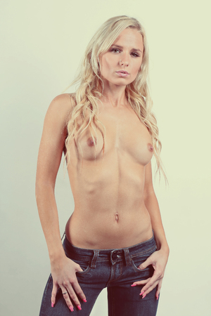 Topless woman in jeans denim