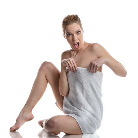 Beautiful woman wrapped in a towel. Spa wellness look
