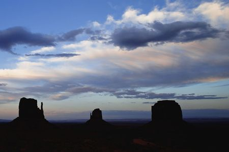 AH9G63 Sunset on Monument Valley Butte Formations better known as the Mittens Monument Valley Navajo Tribal Park Utah Arizona photo