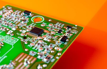 computer hardware with integrated electronic component on orange background Banco de Imagens