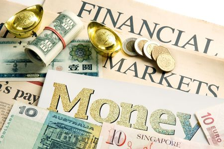Financial news with coins, US dollar bills, Australian dollar, Singapore dollar, Euro, Chinese yuan and gold ingots.