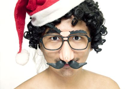 A man in disguise with christmas cap, wig and comedy eyeglases on white background.