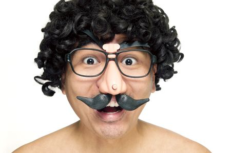A happy man in disguise with wig and comedy eyeglasses on white background.                            Stock Photo