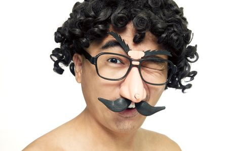 A man in disguise with wig and comedy eyeglasses on white background.