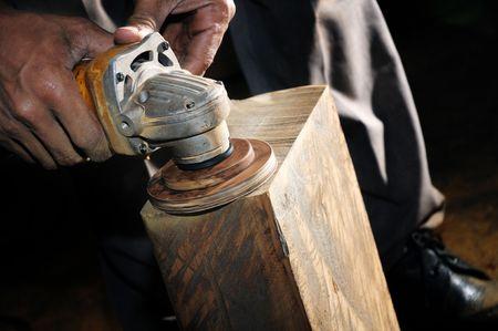 Closeup of carpenter using a power wood sander. Stock Photo