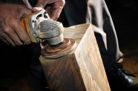 Closeup of carpenter using a power wood sander. Stock Photo