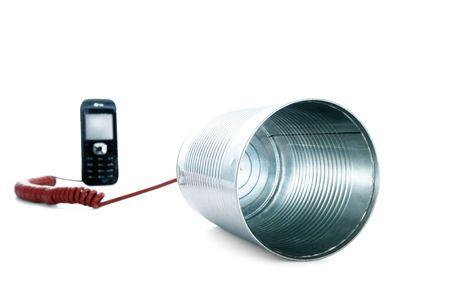 Tin can phone wired to a mobile phone over white background.