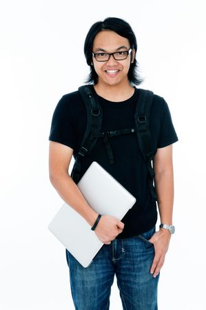 Handsome young male student holding a laptop