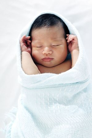 Portrait of a newborn baby sleeping peacefully, wrapped in blanket. Stock Photo - 7215727