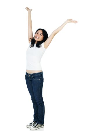 Portrait of a cheerful woman with arms raised on white background.