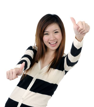 Portrait of a beautiful woman giving thumbs up sign over white background. Stock Photo - 7229659