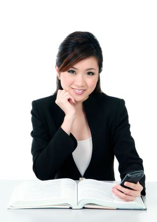 asian office lady: Portrait of a beautiful young businesswoman holding a mobile phone over white background.