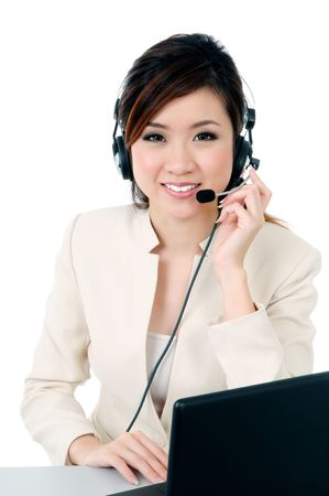 Portrait of a cheerful businesswoman wearing headset against white background. photo