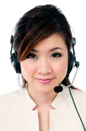 Portrait of a cheerful businesswoman wearing headset against white background.