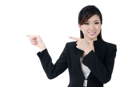 Portrait of a beautiful young businesswoman pointing at copy space, isolated on white.
