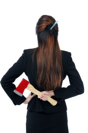 Businesswoman holding an axe behind her back, isolated on white.