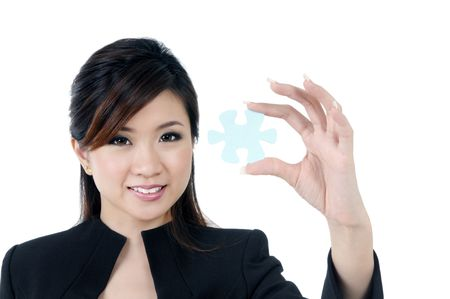 Portrait of a beautiful young businesswoman holding a jigsaw puzzle, isolated on white.