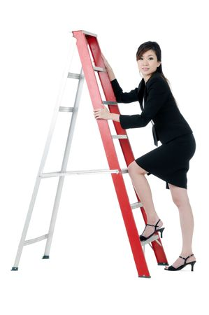 Portrait of a beautiful young businesswoman climbing up a ladder, isolated on white background.