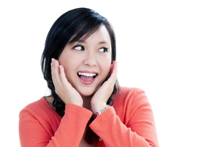 Portrait of an attractive young woman looking surprised over white background. Stock Photo - 8613020