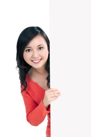 Portrait of an attractive young woman holding a billboard, over white background. Stock Photo