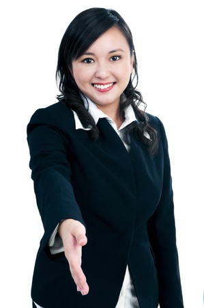 Portrait of a beautiful businesswoman offering handshake over white background. photo