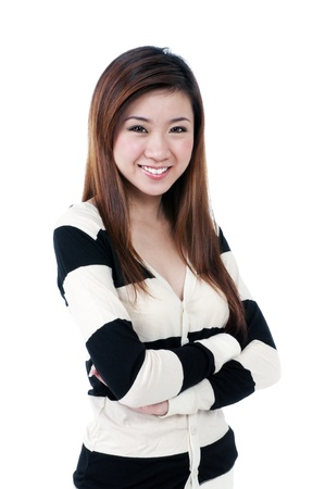 Portrait of a beautiful young woman smiling against white background.