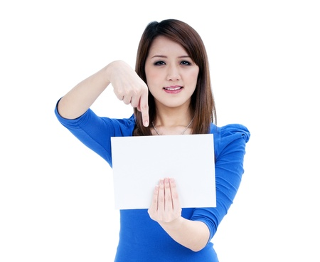 Portrait of a cute woman holding and pointing to a blank note card, isolated on white background. Stock Photo - 9815277