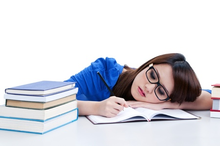 Casual young student writing and head resting on arm, over white background. Stock Photo
