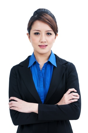 Portrait of an attractive business woman with arms crossed, isolated on white background. photo