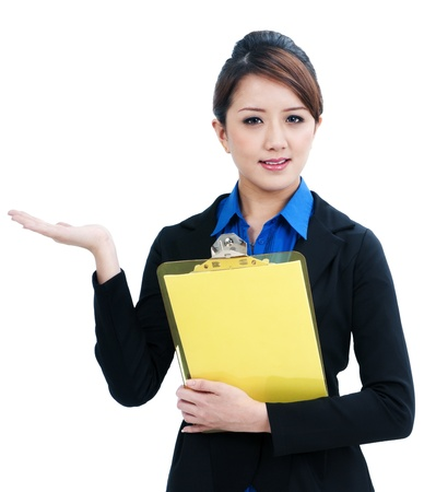 Portrait of a beautiful young businesswoman gesturing and holding clipboard, isolated on white background. photo