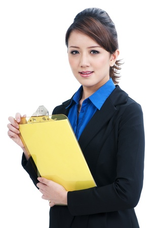 Portrait of an attractive business woman holding clipboard, isolated on white background. photo