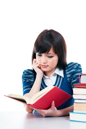 Portrait of a cute female student studying over white background. Stock Photo