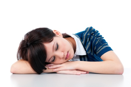 catnap: Portrait of a young Asian woman sleeping gracefully over white background.