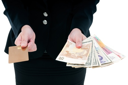 Close-up of a businesswoman holding credit card and money
