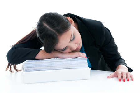 snooze: Tired businesswoman taking a nap over white background
