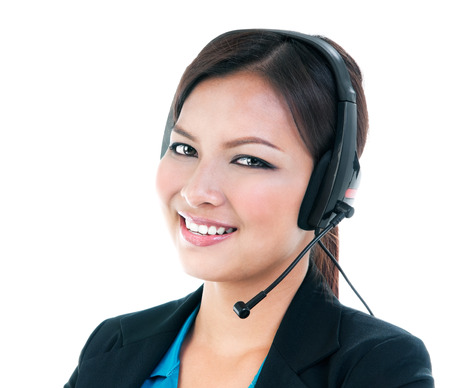 telephonist: Portrait of a cute young businesswoman with headset, isolated on white