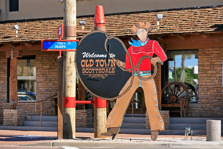 Old Town Scottsdale cowboy sign in historic shopping district Scottsdale Arizona 스톡 콘텐츠